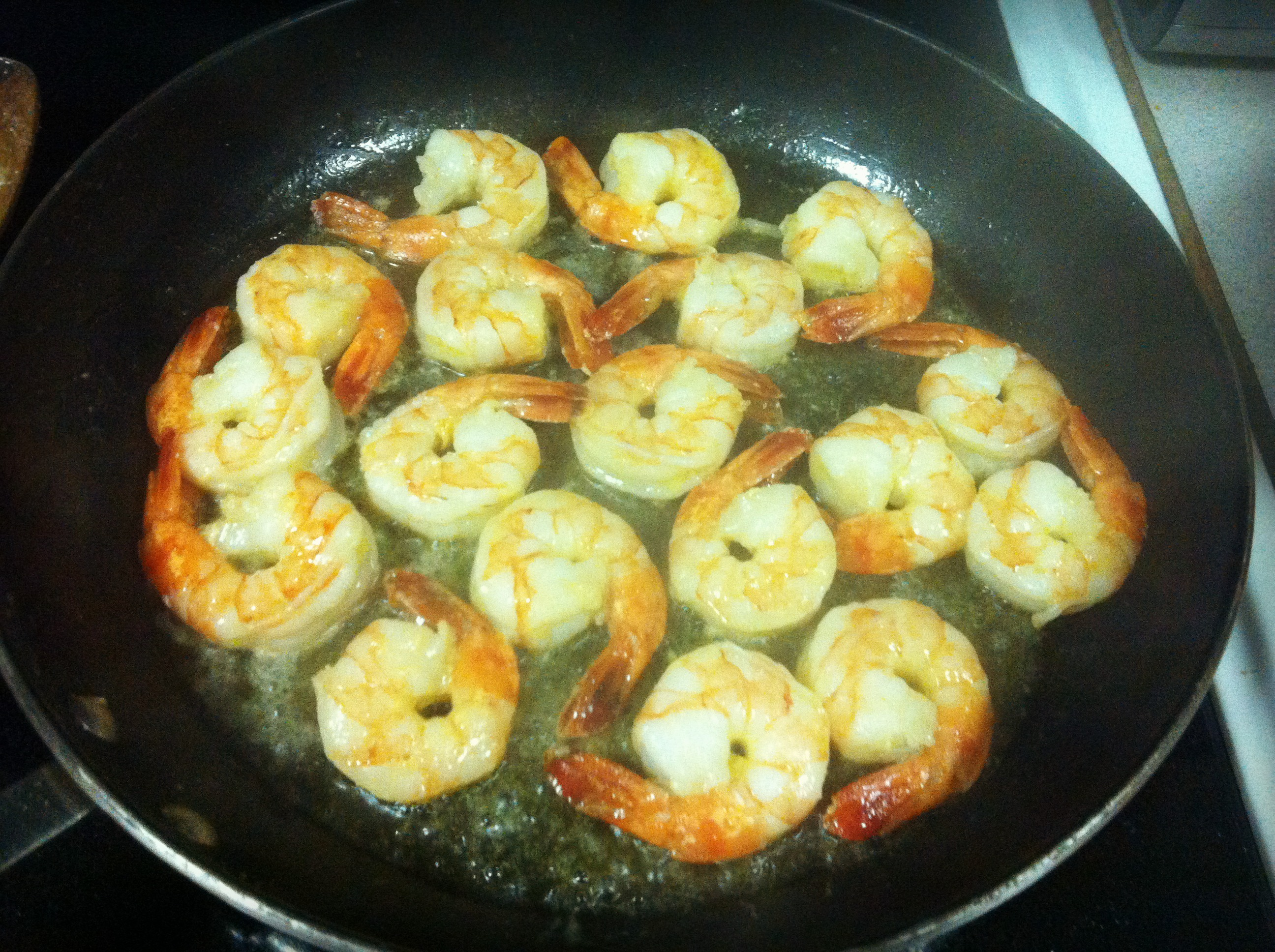 Transfer the shrimp to a bowl with a slotted spoon, while keeping the ...